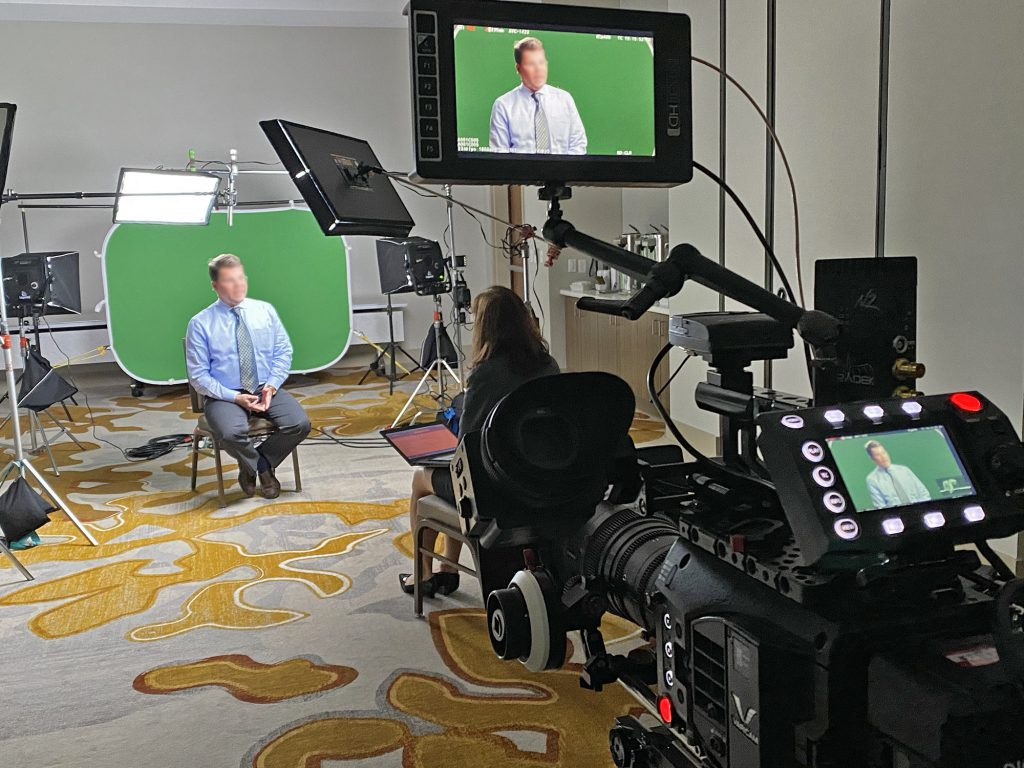 Video production setup of a doctor interview on green screen studio in a hotel conference room.